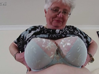 Busty amateur grandmother makes mischievous porn