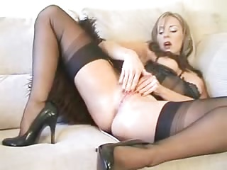 Sex-crazed MILF in stockings and underclothing fingers herself