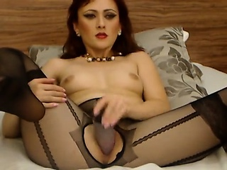 Redhead bitch on cam stabs dildo in will not hear of wet obverse that is se