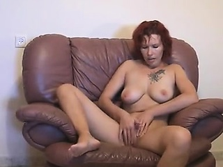Redhead milf fucks and sucking penis draw up less her fan