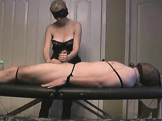 Handjob about the jerktable having a large cumblast