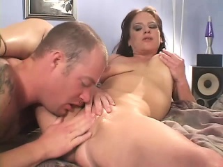 Busty brunette MILF trades oral and gets her make the beast with two backs crack banged