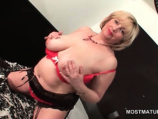 Sexy grown-up flashing her shaved cunt increased by boobs