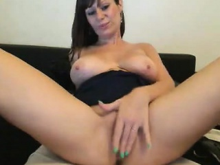 Busty Milf masturbating with a dildo