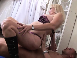 Stimulated bitch sucks clientele dick in a clothes sell out