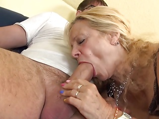 Busty GILF takes young cock in her aged holes