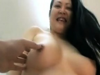 Jap milf teasing impoverish with will not hear of big boobs