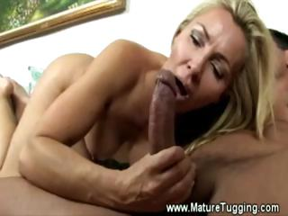 Hot mama plays with young cock
