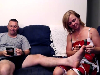 Brunette concerning foot fetish rubs chunky dick concerning their way paws in POV